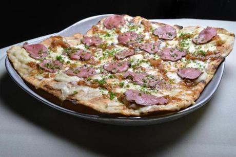 Thin-crust pizza with beef tenderloin, mashed potato, and truffle oil.